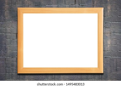 wooden brown frame on stone gray wall
