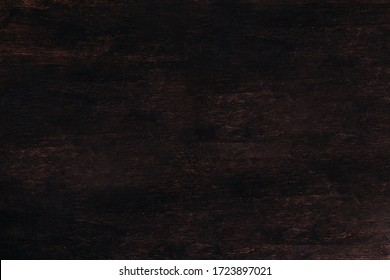A wooden a brown wooden table.Wood Dark background texture.