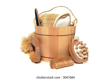 A wooden bucket full of beauty items isolated on white