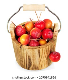 Wooden bucket full of Paradise apples isolated on white
