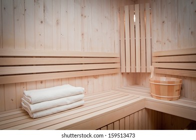 wooden  bucket and white towels in a sauna