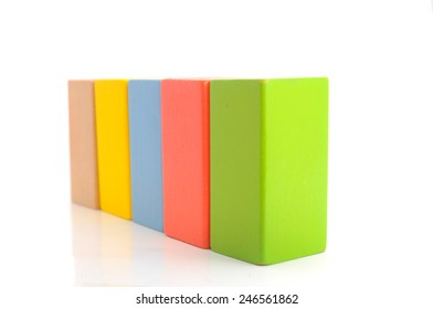 Wooden building block on white background.