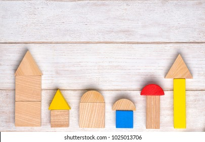 Wooden building blocks background. Kids toys background. Top view. Flat lay. Copy space for text.