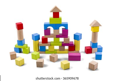 Wooden building castle of colorful blocks isolated on white with clipping path