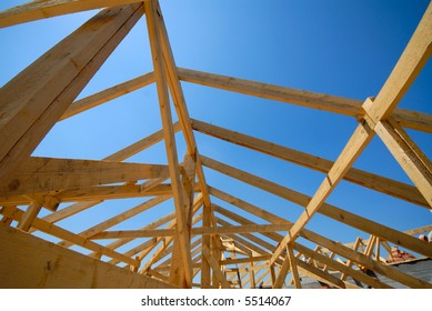 wooden building designs on  background of  blue sky