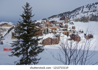 Wooden buildings perched on the cliff side in the Alpian ski resort of Avoriaz.