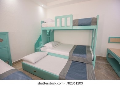 Wooden bunk beds in family room of a luxury hotel resort with steps