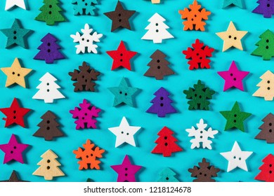 wooden buttons made of wood for the Christmas holiday. Christmas trees, stars, snowflakes.
