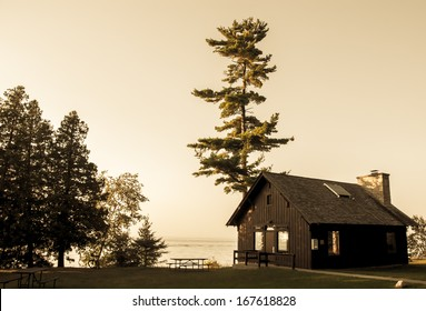Wooden cabin by the lake, vintage photo