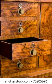 wooden cabinet with drawer, beautifully textured with keyholes and handles