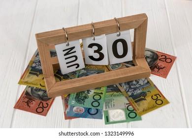 Wooden calendar with australian dollars on table