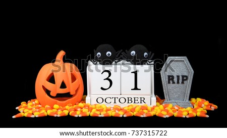 wooden calendar blocks depicting date for halloween october 31st on a black background with