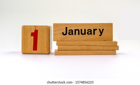 Wooden calendar. January 1st. Day 1 of january month, calendar. Happy New year, Winter time.