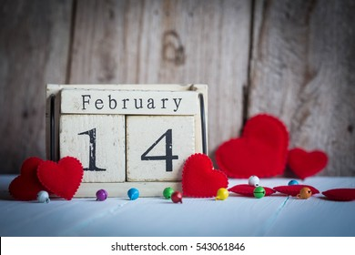 Wooden calendar show of February 14 with red heart
