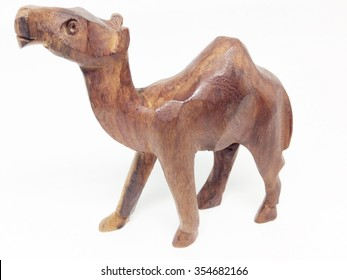 Wooden Camel toy on white background. A souvenir.