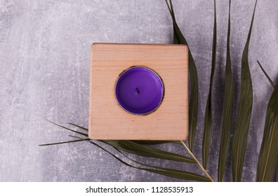 A wooden candlestick on the table