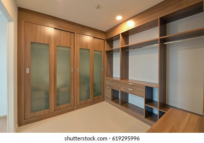 wooden carbinets in dressing room in modern home, interior design
