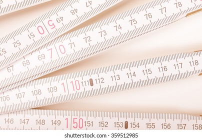 Wooden carpenter ruler for measurements in building site vintage