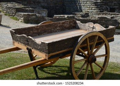 Wooden cart in the courtyard of a medieval fortress