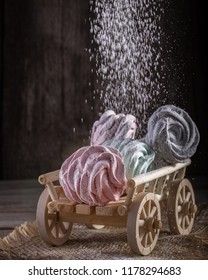 A wooden cart with homemade sweet marshmallow.  Meringue, Zephyr. Homemade sweets