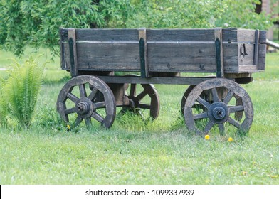 wooden cart on the lawn