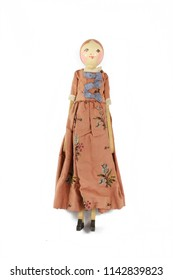 Wooden Carved Antique Doll on White Background