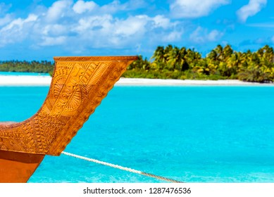 Wooden carved boat on a sandy beach in Aitutaki island, Cook Islands, South Pacific. With selective focus