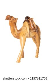 Wooden carved camel isolated on white background. Place for your food and display product montage.