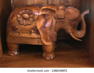 wooden carved elephant with trunk up