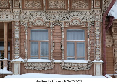 Wooden carved frames on wooden houses of Russian villages.History of Russian windows