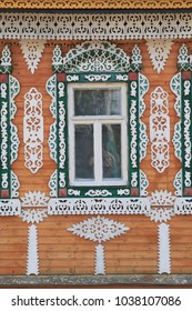 Wooden carved frames and windows on wooden house in Russian village
