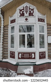 Wooden carved frames and windows on wooden house in Tomsk city (Russia)