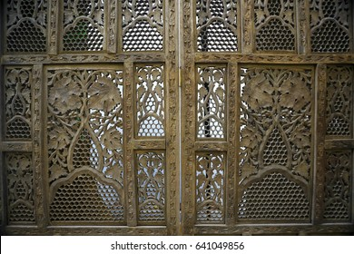Wooden carved screen near the wall in the room