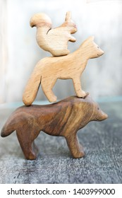Wooden Carving Hand Made Organic Toys for Children. Ecological Smart Living and Education Concept. Environmental Friendly Stuff. Eco Home and Zero Waste. World of Play with Animals.