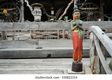 Thai greeting images stock photos vectors shutterstock wooden carving representing thai greeting posture hello welcome m4hsunfo Gallery