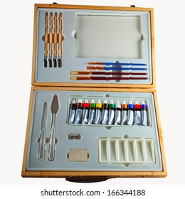 Wooden case with painting instruments isolated over white