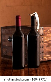 Wooden case with two bottles of red wine with corkscrew