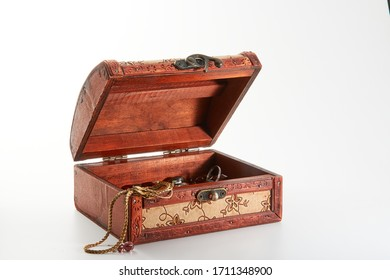 Wooden casket with jewelry on a white background