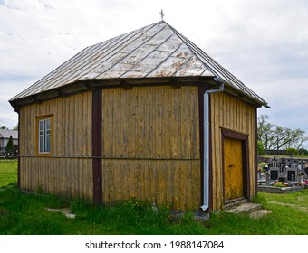 A wooden Catholic chapel, built in 1811, located in the cemetery in Turośl in Podlasie, Poland. - Shutterstock ID 1988147084