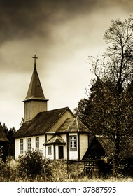 Wooden catholic church under heavy skies