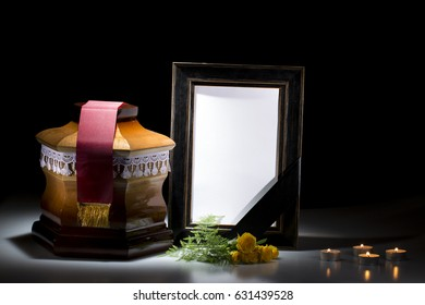 Wooden cemetery urn with blank mourning frame