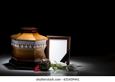 Wooden cemetery urn with small black mourning frame