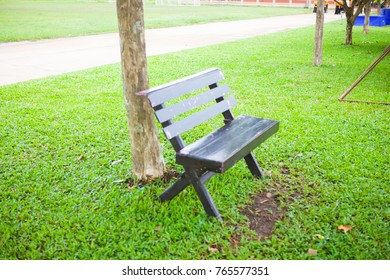 The wooden chair beside the grass.