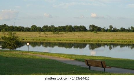 Wooden chair by the lake in Heartland,Texas.
