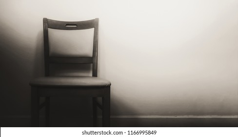wooden chair in the dark shadow