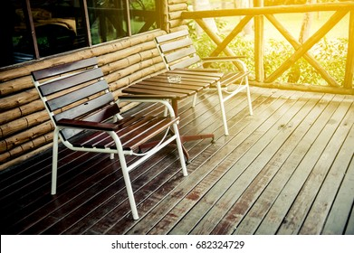Wooden chair in front of the balcony