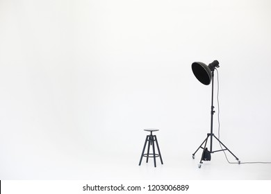 Wooden chair with lighting equipment isolated on a white background. Space for text. Vacant chair. The concept of selection and casting. Job recruitment advertisement.