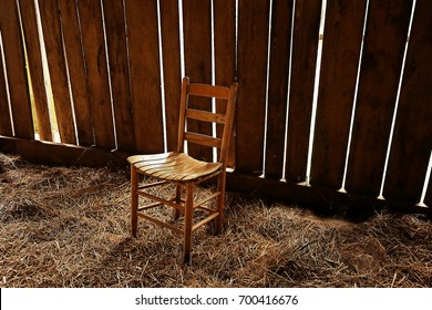 Wooden Chair in an Old Barn