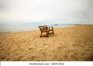 wooden chair on beach side. feeling alone