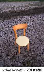 Wooden chair on the crack soil